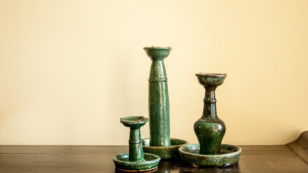 Chinese ceramic turquoise candle holders in different sizes in a weathered state