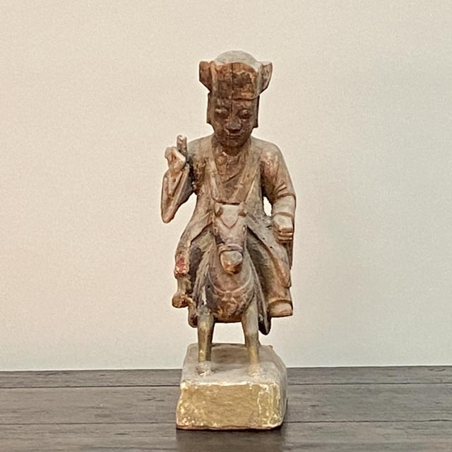 Antique statue of ancestor on a horse.