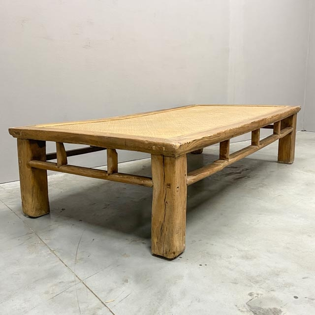 Large antique platform daybed as coffee table