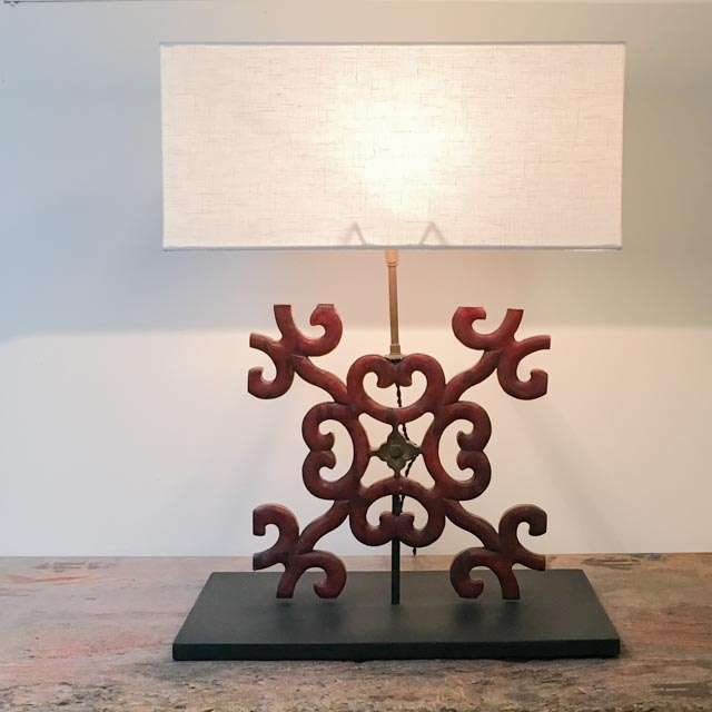 Red wooden decoration as table lamp