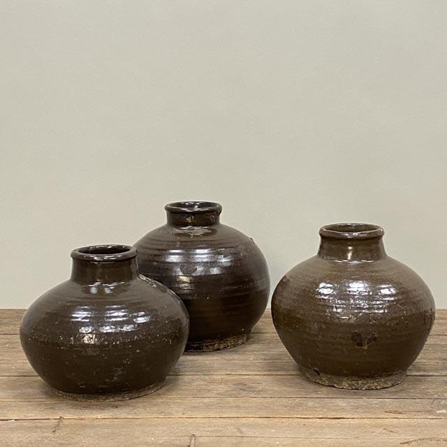 Round brown glazed wine pot