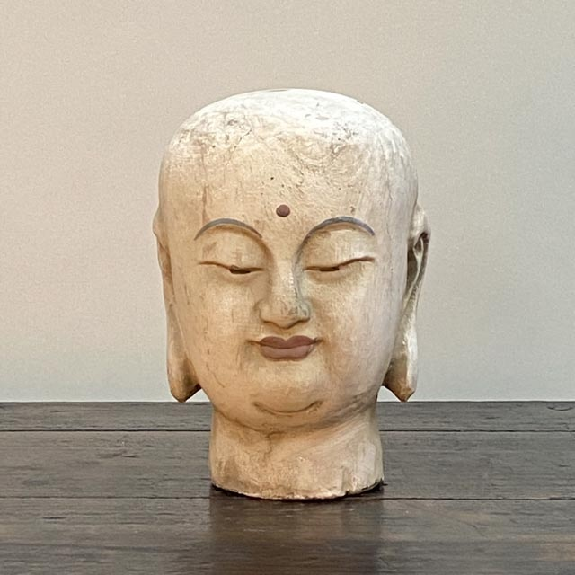 Decorative Buddhist monk head statues