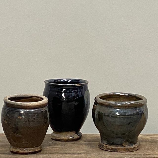 Small antique black pots