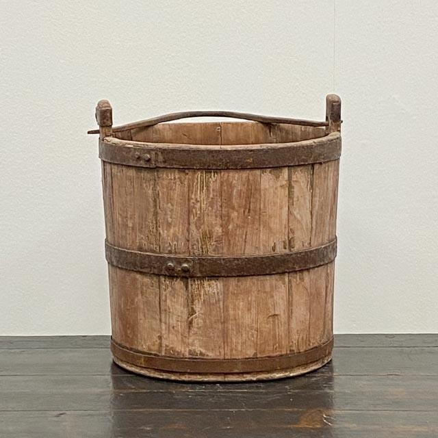 Vintage rustic wooden water bucket.