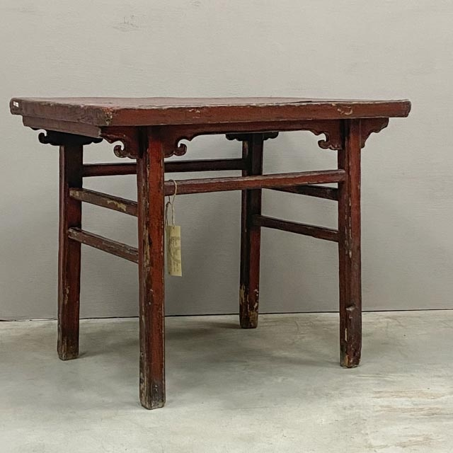 Weathered red lacquer table