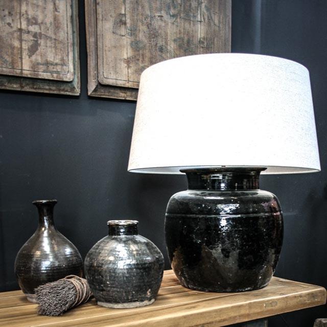 Large black glazed pottery lamp