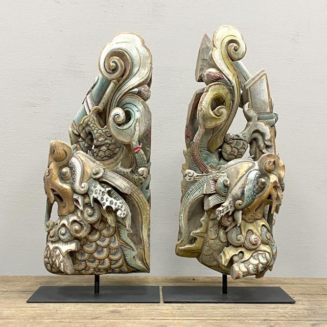 Pair of decorative wooden fish with dragon heads