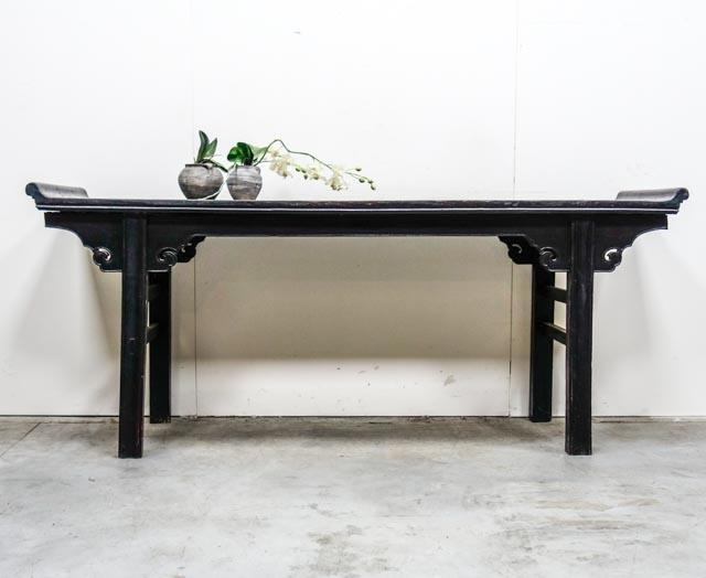 Elegant dark lacquered altar table