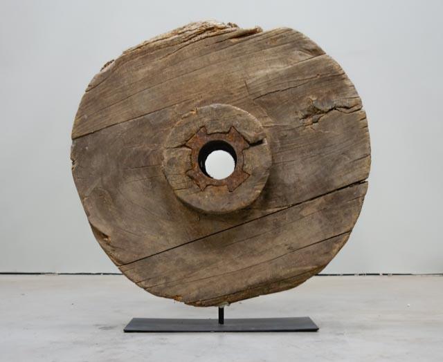 Rustic wooden wheel on metal base