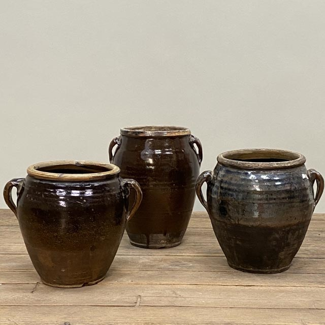 Black glazed pots with thick ears