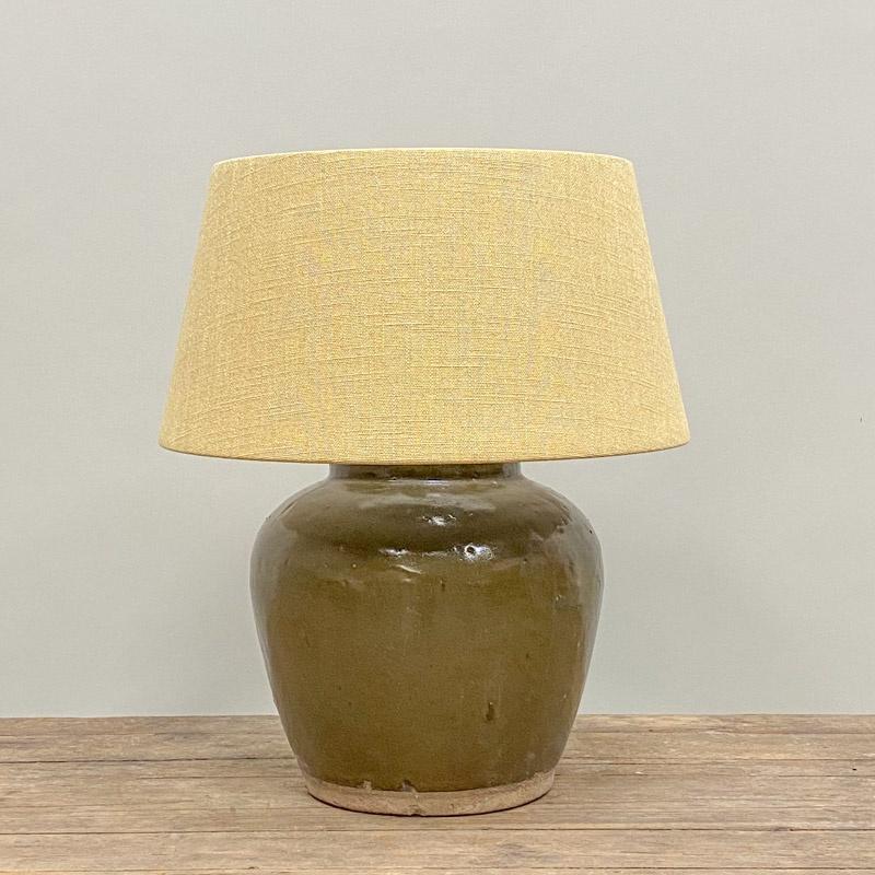 Dark green glazed pottery table lamp