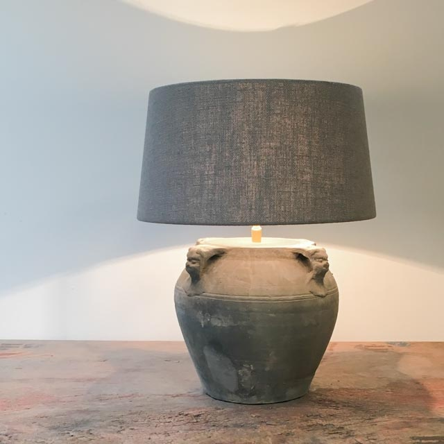 Medium sized grey pottery lamp with 4 lion ears