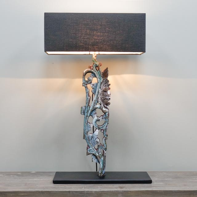 Painted wood carving as table lamp