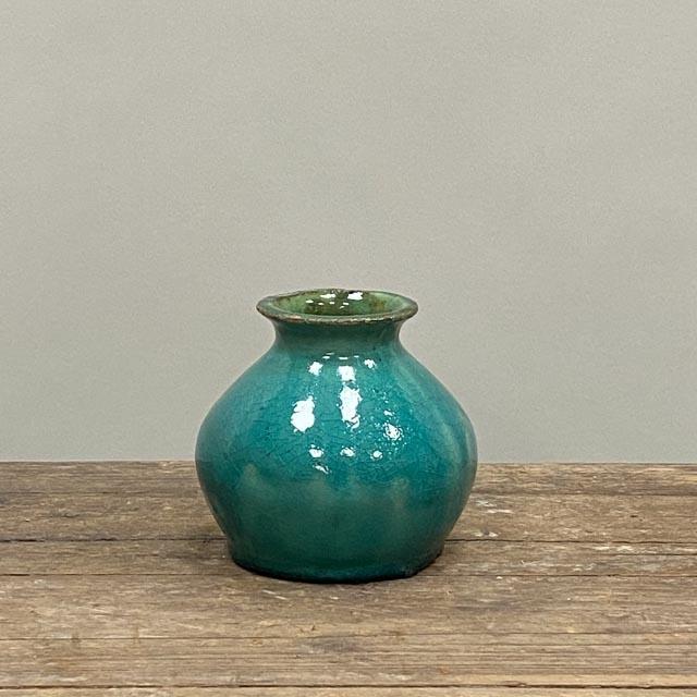 Small turquoise blue vase
