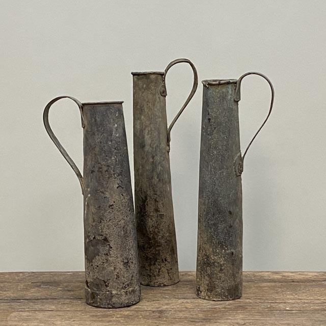 Tall bronze oil holder