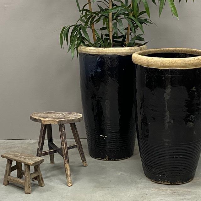 Tall dark glazed planter pot