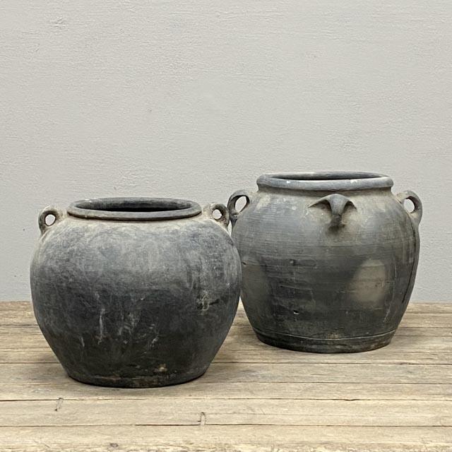 Round unglazed grey pots