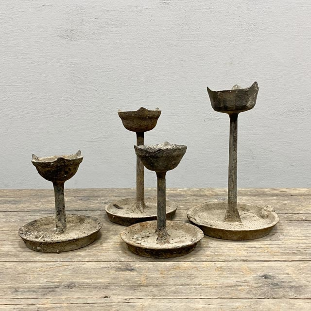 Short antique candle holder with metal base