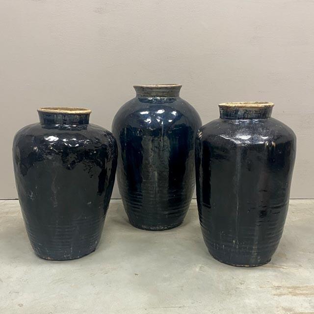 Tall antique black vases