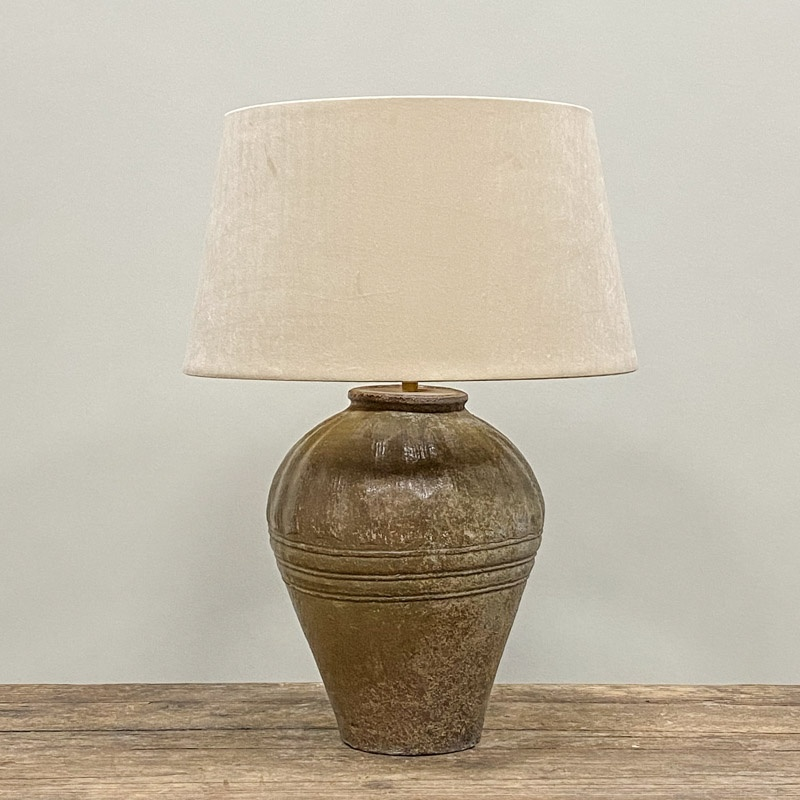 Small olive green storage jar as table lamp