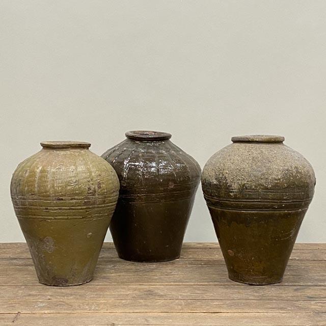 Small olive green storage jars