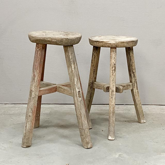 Weathered round wooden stool